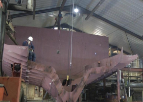 The engine room forard bulkhead is then constructed and the engine bed and bilge tanks attached