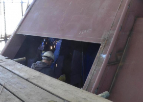 Grinding down a weld on the aft main deck