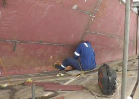 Working on a weld near the bow