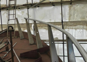 Hand rails are being built around the bow