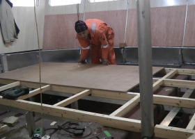 Fitting the floor panels in the wheelhouse