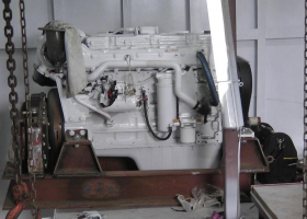 The port auxiliary engine is now in the engine room