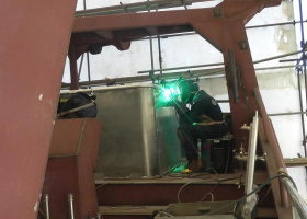 Welding up a net pond on the aft upper deck