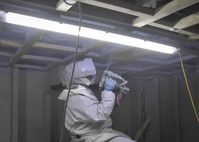 Insulation being sprayed onto the fish room ceiling