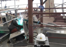 Welding the hatch opening mechanism on the upper deck