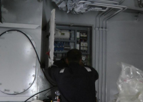 Work in progress on the electrics in the engine room