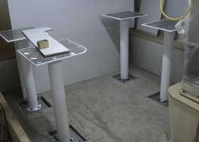 The mounts for the mess tables have been fitted